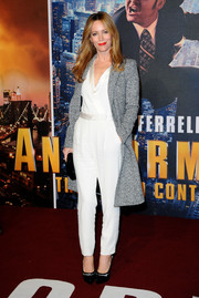 Leslie Mann's gray Saint Laurent wool coat and white jumpsuit at the 'Anchorman 2' premiere were an ultra-stylish combination.
