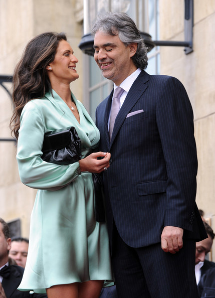 Veronica celebrated with husband Andrea in style in this ultra chic silky mint wrap dress.