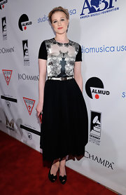Evan Rachel Wood looked delightful at the Andrea Bocelli event in a black-and-white dress with a silk print bodice.