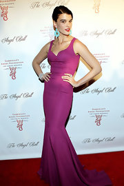 Crystal looked stellar in this fuchsia gown with contrasting turquoise earrings.
