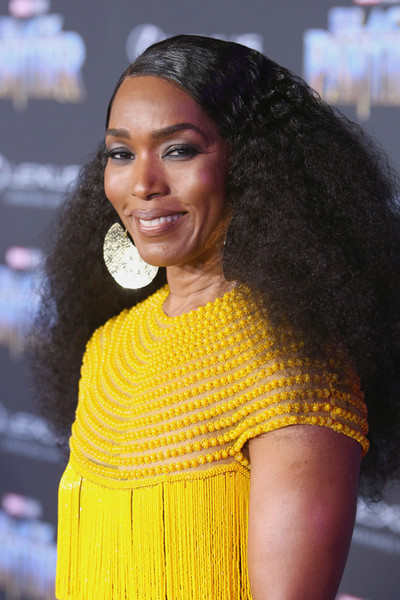Angela Bassett Long Curls [black panther,hair,hairstyle,beauty,yellow,fashion,lip,black hair,long hair,fashion accessory,smile,angela bassett,california,hollywood,dolby theatre,marvel studios,los angeles world premiere]