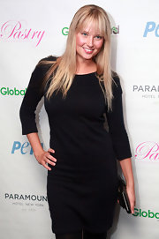 Genevieve Morton looked modest yet elegant in a classic LBD at the unveiling of Angela Simmons' PETA campaign.