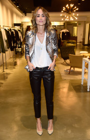 Anine Bing was rocker-glam in a silver sequin jacket layered over a white V-neck tee while celebrating her Los Angeles flagship opening.