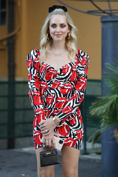 Chiara Ferragni attended the Aniye By fashion show carrying a tiny black Hermes Kelly.