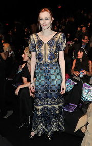 Karen Elson was a vision in the front row of Anna Sui in the designer's v-neck Spring 2011 geometric print gown with contrasting shades of blue and violet.