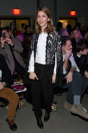 Sofia Coppola jazzed up a simple black shirt with a crocheted cape for the Anna Sui fashion show.