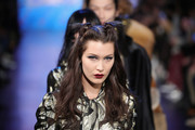 Bella Hadid walked the Anna Sui runway wearing cute half-up knots.