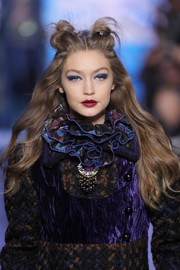 Gigi Hadid looked funky with her half-up knots at the Anna Sui runway show.