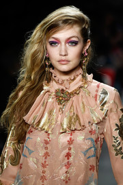 Gigi Hadid was punk-glam with her teased, side-swept hairstyle at the Anna Sui runway show.