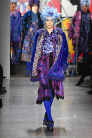 Bella Hadid walked the Anna Sui runway wearing a royal-blue velvet coat over a printed midi dress.