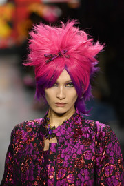 Bella Hadid looked funky with her fuchsia and purple wig at the Anna Sui runway show.