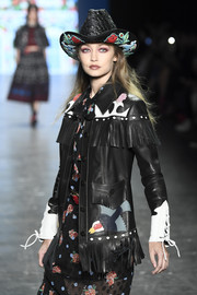 Gigi Hadid looked adorable wearing this floral-embroidered cowboy hat while walking the Anna Sui runway.