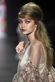 Gigi Hadid rocked a half-up beehive at the Anna Sui fashion show.