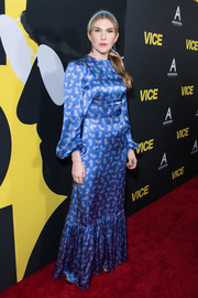 Lily Rabe went the ladylike route in a long-sleeve blue satin gown by The Vampire's Wife at the premiere of 'Vice.'