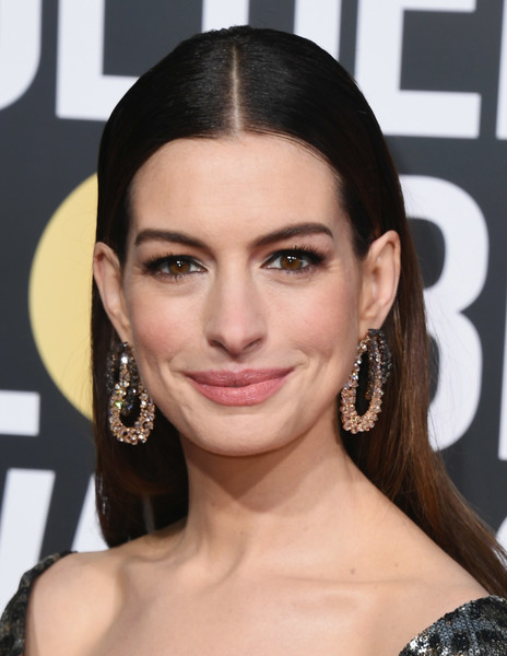 Anne Hathaway Long Straight Cut [hair,face,hairstyle,eyebrow,lip,skin,beauty,chin,forehead,black hair,arrivals,anne hathaway,the beverly hilton hotel,beverly hills,california,golden globe awards]