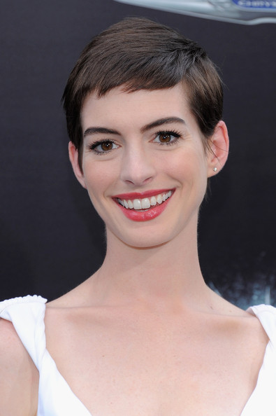 Anne Hathaway Pixie [the dark knight rises,hair,face,eyebrow,hairstyle,lip,chin,skin,facial expression,forehead,beauty,anne hathaway,inside arrivals,new york,amc lincoln square theater,new york premiere]