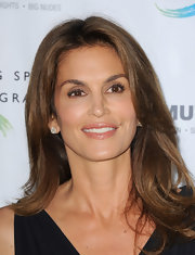 Cindy Crawford showed off her signature brunette locks with a thick and voluminous layered cut.