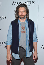 When in doubt, layer! Anson Mount added depth to his look by topping his denim jacket with a comfy looking fleece vest.