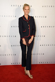 Eva Herzigova glammed up her outfit with bow-adorned gold heels.