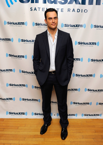 Wearing a charcoal suit and white button-down, Cheyenne Jackson looked elegant in a laid-back way.