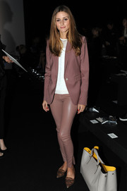 Olivia Palermo sported a monochromatic yet chic ensemble at the Anya Hindmarch fashion show, consisting of leather skinnies and a blazer.