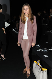 Olivia Palermo opted for a simple yet stylish mauve blazer and leather skinnies combo at the Anya Hindmarch fashion show.