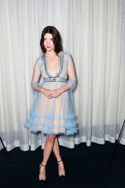 Anya Taylor-Joy Cocktail Dress [the witch,clothing,blue,dress,fashion,leg,cocktail dress,event,fashion design,performance,sitting,anya taylor joy,california,hollywood,arclight cinemas,a24,red carpet,premiere]