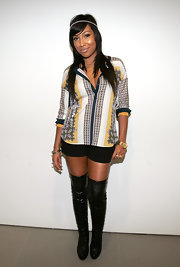 Melanie Fiona slipped on a pair of black over the knee boots for an appearance at the West 14th Street Apple store in NYC.