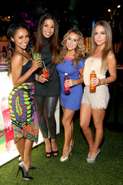 Alexa Vega showed plenty of leg in a blue mini skirt with pink neckline detail during the Aquafina FlavorSplash launch.