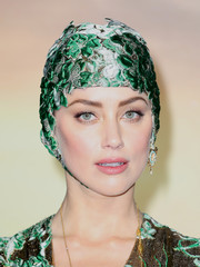 Amber Heard was on theme in this brocade skull cap at the world premiere of 'Aquaman.'