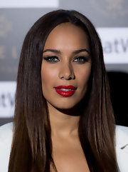 Leona Lewis added a glamorous touch to her smoky-eyed look at the Ariella Couture fashion show with a pair of false lashes.