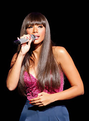 At the Arise Made in Africa Spring 2012 designer collection, Leona Lewis rocked a long, straight cut with bangs. Her lash-length fringe emphasized flirty lashes.