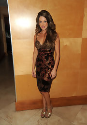 Angela shimmered in a bronze cocktail dress with a textured print.