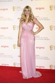 Holly Willoughby opted for a softy cotton candy pink gown with a jeweled belt for her red carpet look.