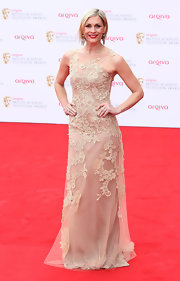 Jenni Falconer chose this nude sleeveless tulle dress that featured lace flower embroideries for her look on the red carpet.