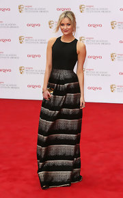 Laura Whitmore chose this floor-length skirt that featured a gold and black striped design for her evening look at the BAFTA TV Awards red carpet.