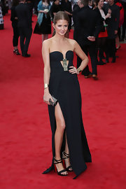 Millie Mackintosh's strapless black dress had a cool contemporary vibe to it with its metallic bust embellishment and its high leg slit.