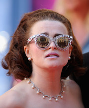 Helena Bonham Carter accessorized with embellished cateye sunglasses for added flair.