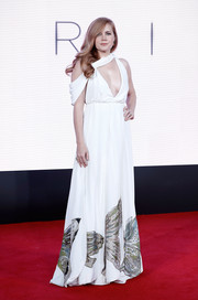 Amy Adams attended the BFI London Film Festival screening of 'Arrival' looking like a goddess in a Valentino Couture gown with an asymmetrical, plunging neckline and a butterfly-print skirt.