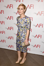 Liza Weil looked vibrant at the AFI Awards in a floral dress in splashes of yellow, purple and white.