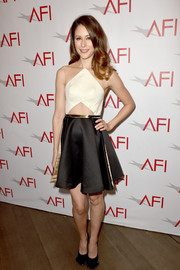 Amanda Crew playfully styled her frock with a pair of black fringe-toe pumps.