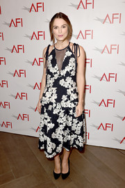 Keira Knightley made an ultra-girly statement at the AFI Awards in a sheer-panel floral dress by Erdem, complete with peplum detailing that disguised her baby bump.
