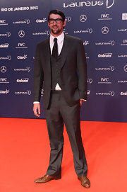 Michael Phelps showed off his dapper style with a classic three-piece suit.