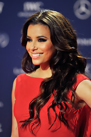 Eva Longoria showed off her chocolate locks with thick, long waves.