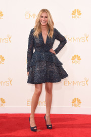 Forever the pretty woman, Julia Roberts got all dolled up in an intricately beaded dark-blue peplum dress by Elie Saab for the Emmys.
