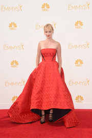January Jones chose a red Prabal Gurung strapless gown with a voluminous skirt and a high-low hem for the Emmys.