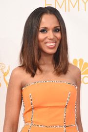Kerry Washington totally embraced color, pairing her orange dress with blue eyeshadow.