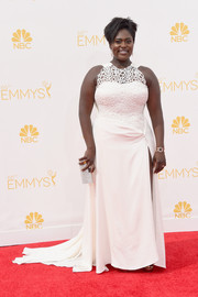 Danielle Brooks sheathed her curves in a white Nathaniel Paul gown, featuring a mesh bodice and a thigh-high slit, for the Emmys.