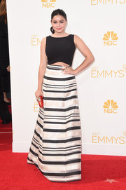 Ariel Winter showed off her cool red carpet style in a Black Halo Eve gown featuring a midriff cutout and a monochrome striped skirt during the Emmys.