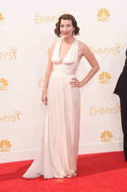 Kristen Schaal chose a sexy-glam white Grecian gown for her Emmys look.